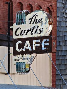 The Curtis Cafe Stafford, Kansas. The walls are lined with completed jigsaw puzzles, the menus are hand written and the pie homemade at this small town time capsule