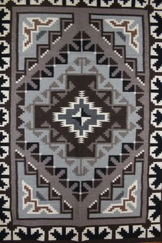 """Navajo Weaving 102. Description: Navajo Weaving. 4'11"""" x 3'5"""". Two Grey Hills area. Woven by Bernice Phillips. Excellent Condition. ---------- A Brief Social History of Navajo Weaving and a bit of his"""