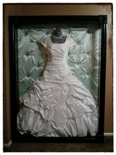 My wedding gown was too gorgeous to stuff away in a box in the back of my closet. So my dad and I designed and built this shadow box to display and preserve it :)  Thank you dad for all your hard work. You're the best!