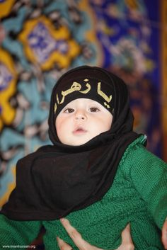 A little one during the mourning of Muharram inside the shrine of Imam Hussein