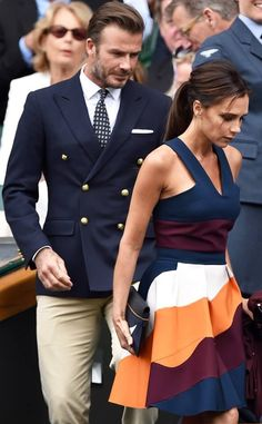 Victoria and David Beckham. They are leaving Centre Court at Wimbledon for the men's final. They were seated in The Royal Box.