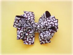free instructions for triple stacked bow from The RIBBON RETREAT... lots of other free instructions too