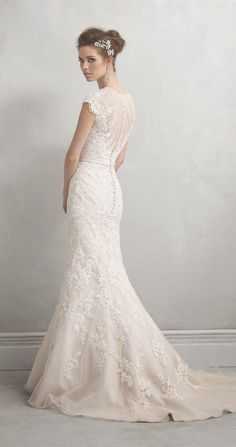 Such a gorgeous lace wedding gown and the perfect hair accessory to complement it. Dress: Allure Bridal via Yes Missy