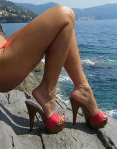 Red mules, anklet, and great legs