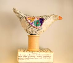 A little birdie told me Paper mache bird with vintage fabric wings on vintage wooden spool. Etsy.