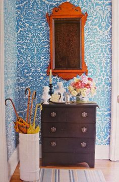 Entry with cheery blue wallpaper. Chipendale cherry wood mirror