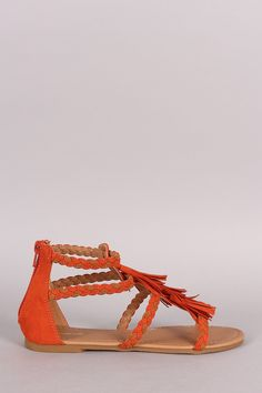 Description This chic sandal features an open toe silhouette, two-tone braided vamp straps adorned with tassels, lightly padded insole, and convenient back zip closure. Material: Vegan Suede (man-made