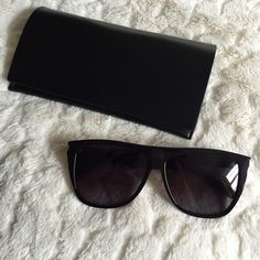 Saint Laurent SL1 Sunglasses - Black 100% Authentic, lightly used YSL SL1 sunglasses in Black/Black. As seen on Kim Kardashian. There is minimal wear on these sunglasses, sold out online. Comes with original YSL case. Yves Saint Laurent Accessories Sunglasses