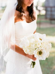 wedding bouqet with white roses, hydrangeas, and magnolias (all my favorites!!!)-via Brittney Sandra