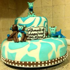 Jungle themed baby shower cake in aqua
