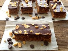 Peanut Butter Biscuit Bars packed full of peanut butter deliciousness, topped with dark chocolate to cut through the sweetness and last of all, an extra peanut hit with salty, crunchy peanuts.