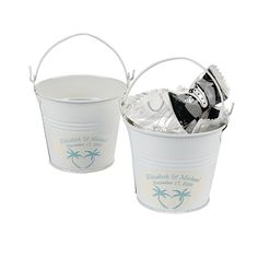 "Personalized Beach Theme White Pails. What a cute table decoration for the wedding reception! Fill these little buckets with sand and shells for a fun tropical look or stuff them with candy and small party favors. Personalize the stickers with 2 lines of 20 characters/spaces per line. Tinplate. 3 1/4"" diam. x 3"" Not food safe, use wrapped candy only. Simple assembly required.  © OTC"