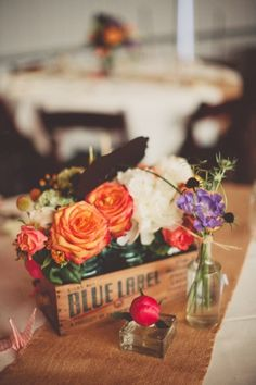 maybe sivan can start saving some booze boxes for centerpieces? with picked flowers?