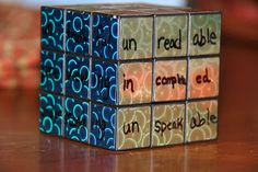 Teaching prefixes and suffixes with a cube.