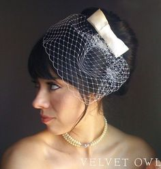 love the bow with netting that doesn't quite cover the face (by VelvetOwl on Etsy)