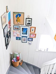 Create a colorful #gallery to brighten up a staircase landing. Place artwork in the corner for a more interesting look! Search thousands of beautiful #frame options here: http://www.pictureframes.com/ #walldecor