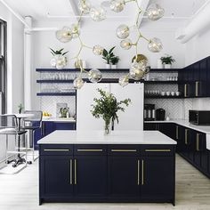 Modern Kitchen Interior Moody blue cabinets with brass pulls and a dramatic bubble chandelier create an elevated communal kitchen. - Moody blue cabinets with brass pulls and a dramatic bubble chandelier create an elevated communal kitchen. Interior, Home, Kitchen Remodel, Home Remodeling, Interior Design Kitchen, Communal Kitchen, Home Kitchens, Kitchen Renovation, Kitchen Design