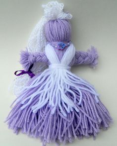 "Lavender Spirit  Doll / Ju Ju Baby / Yarn Poppet: ""Hyacinth"". $12.00, via Etsy."