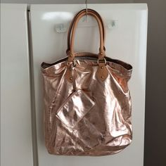 "JCREW Rose Metallic Tote JCREW Rose Gold Metallic Tote. Antique gold hardware. All leather including handles NWOT. Length 16"" width 15""handle drop 9"". Coin purse included. Interior pocket. J. Crew Bags Totes"