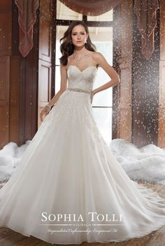 Sophia Tolli - Peyton. Strapless sweetheart organza wedding dress with lace appliqués and a hand-beaded crystal belt, A-line silhouette with semi sheer back and back corset, chapel length train
