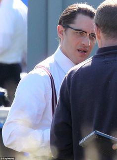 Enigmatic: Tom cut a suave figure in his elegant spectacles as he began fliming the gangster movie