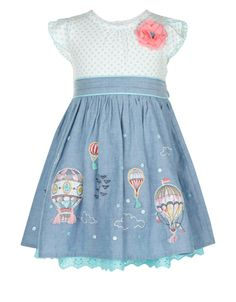 This pretty dress for baby girls is adorned with a ditsy floral-print jersey bodice with a 3D rosette and cap sleeves. The denim chambray skirt is decorated with hot air balloon appliqués, embroidered clouds and sparkling sequins, and accented with a broderie anglaise trim.