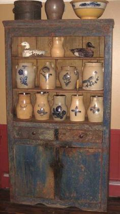 Old Worn Blue Cupboard...with old crocks.