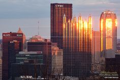 Downtown Pittsburgh reflecting the sun - PittsburghSkyline.com