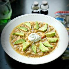 This version of chili is made with chicken and Great Northern Beans.  It's topped off with sliced avocados and Greek yogurt.