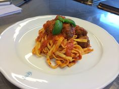 Pasta with a spicy tomatosauce and meatballs, all homemade