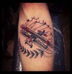 Old school plane tattoo by Ben Koopman.