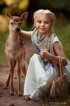 Beautiful girl with baby deer