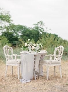 Elegant + ethereal gray wedding table decor: http://www.stylemepretty.com/canada-weddings/british-columbia/vancouver/2015/11/06/ethereal-greek-goddess-inspired-wedding-editorial/ | Photography: Vasia - http://www.vasia-weddings.com/