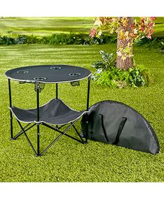 Create a home away from home starting with this Folding Camping Table with Shelf. It gives you a tabletop and 4 cupholders for camping, picnics, sporting events and Camping Car, Camping World, Camping Hacks, Outdoor Camping, Camping Lunches, Rv Hacks, Camping Checklist, Camping Kitchen Table, Folding Camping Table