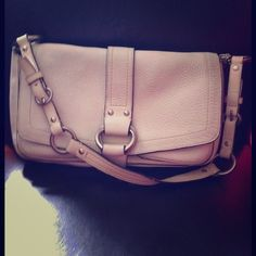 ️HOST PICKCOACH BEIGE LEATHER PURSE VERY NICE ALL BEIGE LEATHER COACH PURSE. HAS SILVER HARDWARE, AND EXCELLENT COMPARTMENTS. (6 in total!) HAS SOME WEAR ON BOTTOM, INSIDE OF PURSE, AND STRAP. NO SCRATCHES, OR TEARS IN LEATHER. IT WOULD PROBABLY CLEAN UP NICELY!!! HAS COACH HANGTAG.  AUTHENTIC!!! Coach Bags