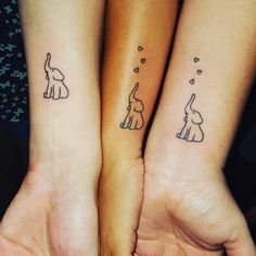 These tiny heart-adorned elephants are a TOO cute idea for a sibling tattoo.