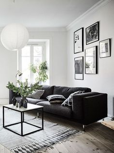 Living room in black, white and gray with nice Gallery wall