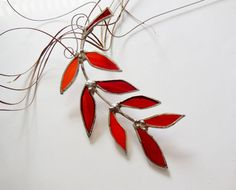 Stained Glass Suncatcher. Red Glass Leaf Branch.  Art glass: red and orange glass for leaf.  Measures: 8  H x 3  W Absolutely stunning in daylight,