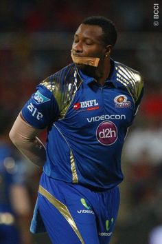 Kieron Pollard of the Mumbai Indians with tape over his mouth during match 16 of the Pepsi IPL 2015 (Indian Premier League) between The Royal Challengers Bangalore and The Mumbai Indians held at the M. Chinnaswamy Stadium in Bengaluru, India on the 19th April 2015.