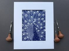 This is an open edition original hand pulled Linocut Print of a Peacock in Prussian Blue by Claire McKay.