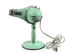 This is a fun, minty green vintage hair dryer, perfect for adding something fun and unique to your home decor.