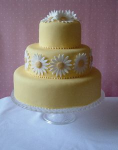Three tier yellow fondant wedding cake decorated with hand made gum past white and yellow daisies. On this page is a huge list of wedding cake categories. Daisy Wedding Cakes, Daisy Cakes, Fondant Wedding Cakes, Fondant Cakes, Gorgeous Cakes, Pretty Cakes, Cupcakes, Cupcake Cakes, Sugar Cake