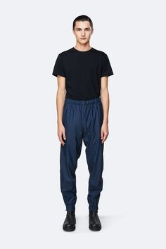 Waterproof rain pants mixing function with fashion. Designed to keep you dry in the rain. Scandinavian design rooted in clean, cool silhouettes. Rain Pants, Harem Pants, Girls Raincoat, Cool Silhouettes, Waterproof Pants, Rain Wear, Legs Open, Thighs, Zipper