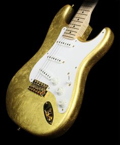 Check out this cool Fender Custom Shop Clapton Signature masterbuilt by Todd Krause. This slick stratocaster electric guitar is finished in Gold Leaf!