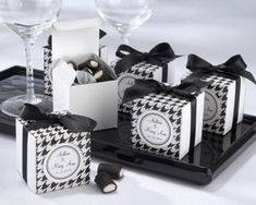 """Black & White Houndstooth Favor Box - Wedding Favor Boxes - Birthday Candy Box - Cupcake Boxes - 10 boxes 2x2x2""""These elegant and chic black and white favor boxes are the perfect gifts for a wedding or a birthday. Details:- Material: Card Paper- Size approx.: 5 x 5 x 5 cm or 2 x2 x 2 inches - Quantity: 10 boxes- Some very easy assembly is required.- Ribbon is included. The stickers are included but not personalized. Can be personalized with an extra cost. - Candies are not included._________ Black And White Wedding Theme, Chanel Party, Birthday Candy, Surprise Birthday, Wedding Favor Boxes, Favour Boxes, Cupcake Boxes, Wedding Wishes, Houndstooth"""