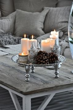 Top Silver And White Christmas Decoration Ideas Silver and white color combination look surreal. It is reminiscent of the icy winter days. So this Christmas, forget the traditional green and red and [. Decoration Shabby, Vibeke Design, Decorating Coffee Tables, Candle Lanterns, Candels, Lantern Centerpieces, Candle Tray, Candle Stands, Candleholders