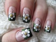 Nail art: Black french manicure with flower and studs