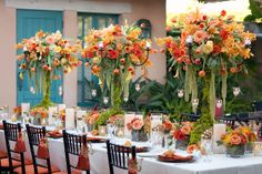 Love the orange, yellow and green in the floral arrangements - Rustic Fall Wedding at Rancho Valencia Resort Fall Wedding Centerpieces, Wedding Reception Decorations, Wedding Table, Table Decorations, Orange Centerpieces, Candelabra Centerpiece, Reception Table, Rustic Wedding, Summer Wedding Colors