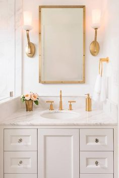 White and gold bathroom with glass knobs
