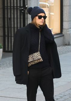 Step up you off-duty look in a black coat and black chinos. Shop this look for $194: http://lookastic.com/women/looks/beanie-and-cable-sweater-and-crossbody-bag-and-chinos-and-coat/3067 — Navy Beanie — Navy Cable Sweater — Tan Leopard Leather Crossbody Bag — Black Chinos — Black Coat